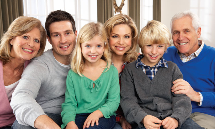 A family of 3 generations, including grandparents, parents, and 2 blonde kids, who share genetics