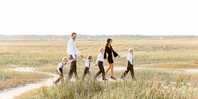Dr. Ammons and his family walking through a scenic field